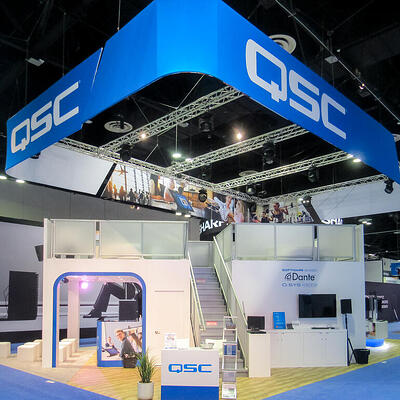 Double decker QSC trade show booth at Infocomm